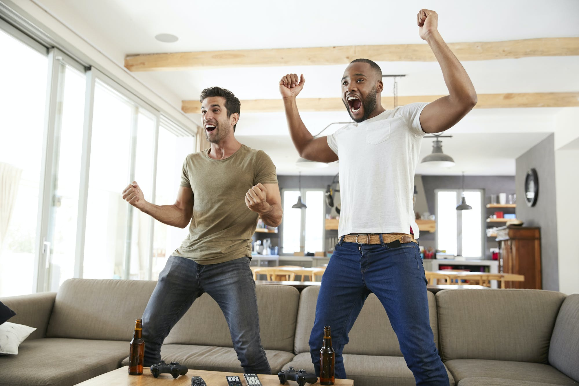 Two excited male friends celebrate watching sports pt5dfkl.jpg?ixlib=rails 2.1